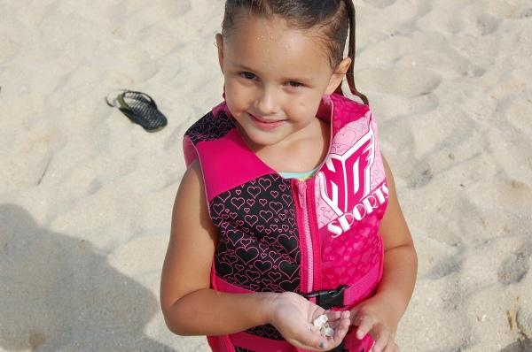 Alana showing off her seashells